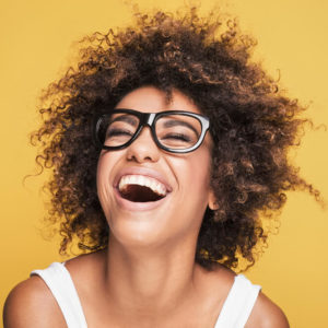 young woman happy and thinking positively