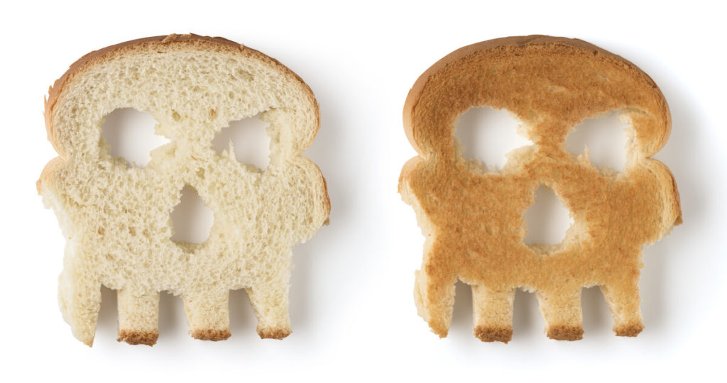 two skull shaped slices of bread isolated