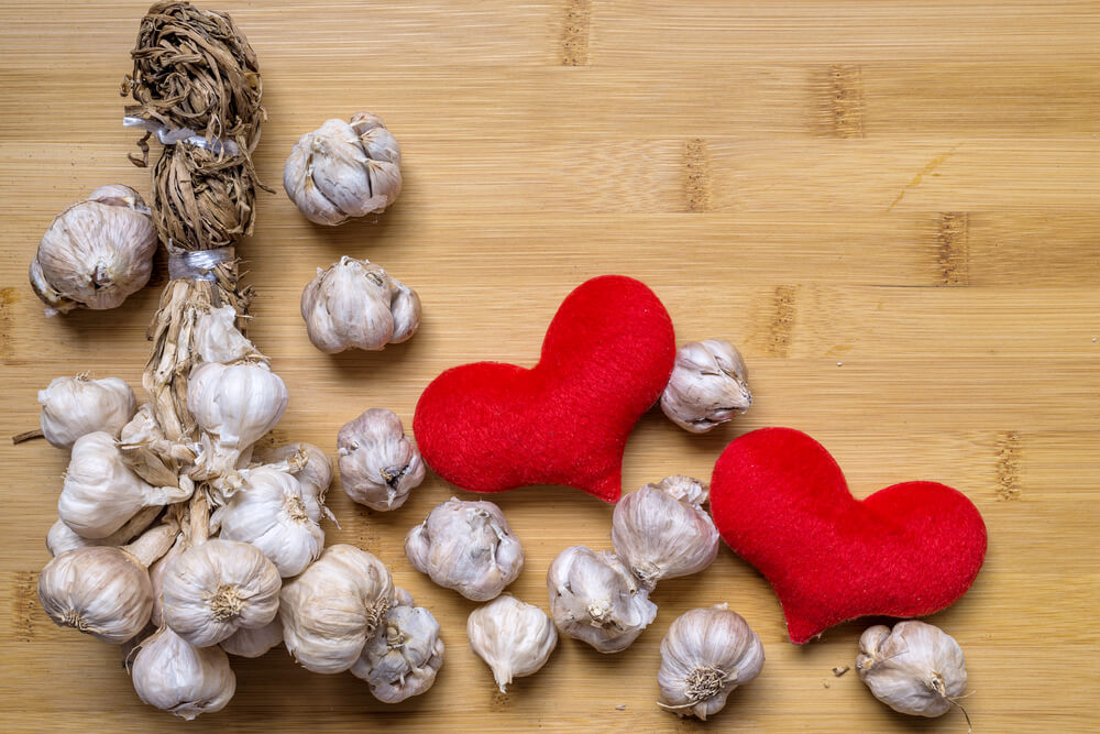 garlic bulbs next to felted hearts