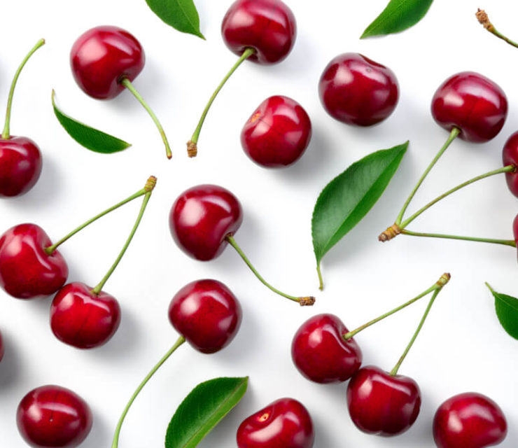 cherries laid out on white background