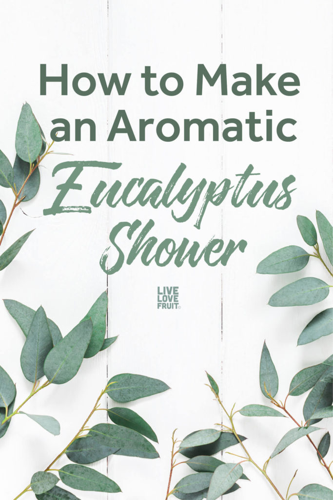 eucalyptus on white wooden background with text How to Make an Aromatic Eucalyptus Shower