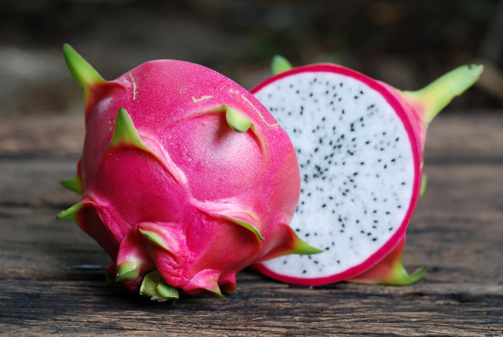 dragon fruit on table cut in half