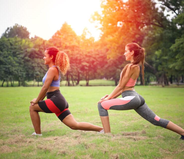 women stretching in field