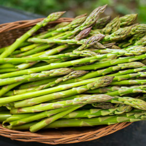 fresh green asparagus in a basket