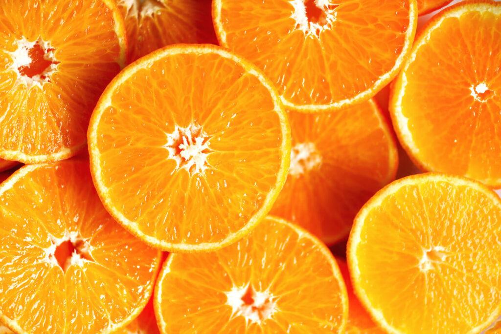 sweet fresh whole and halves of orange fruits