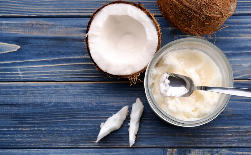 A spoon in a bowl of solid coconut oil
