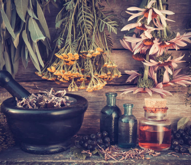 traditional herbal remedies on wood back drop