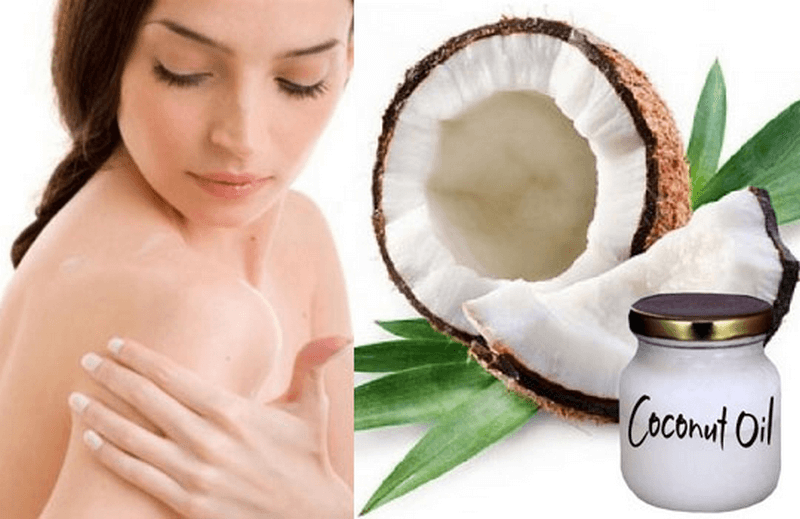 Lady putting coconut oil on her skin