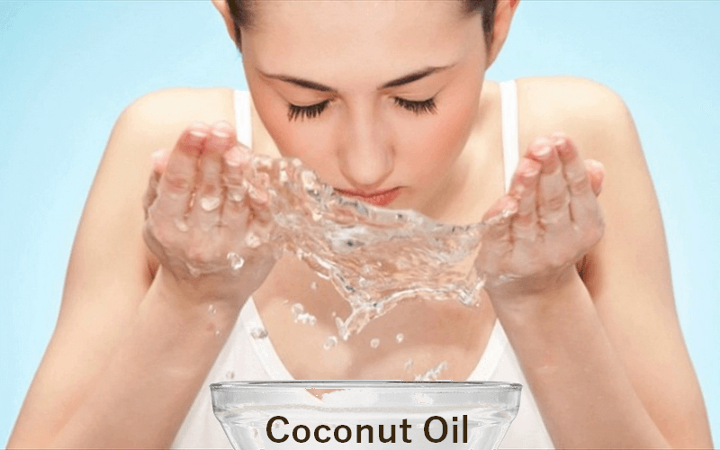 Girl washing face with coconut oil