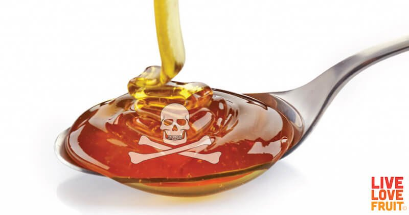 high-fructose corn syrup being poured into spoon with opaque skull