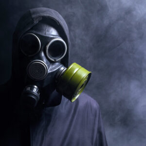 man wearing gasmask in representation of a toxic person