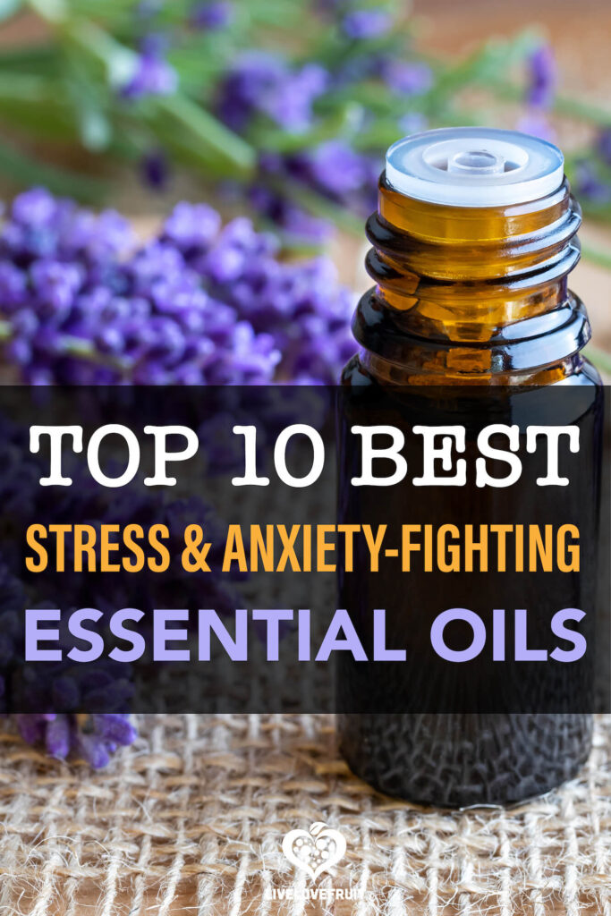 Lavender essential oil with lavender flowers with text - top 10 best stress & anxiety-fighting essential oils