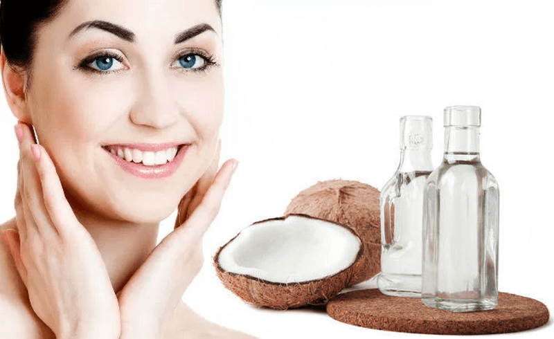 A woman having acne-free skin after using coconut oil