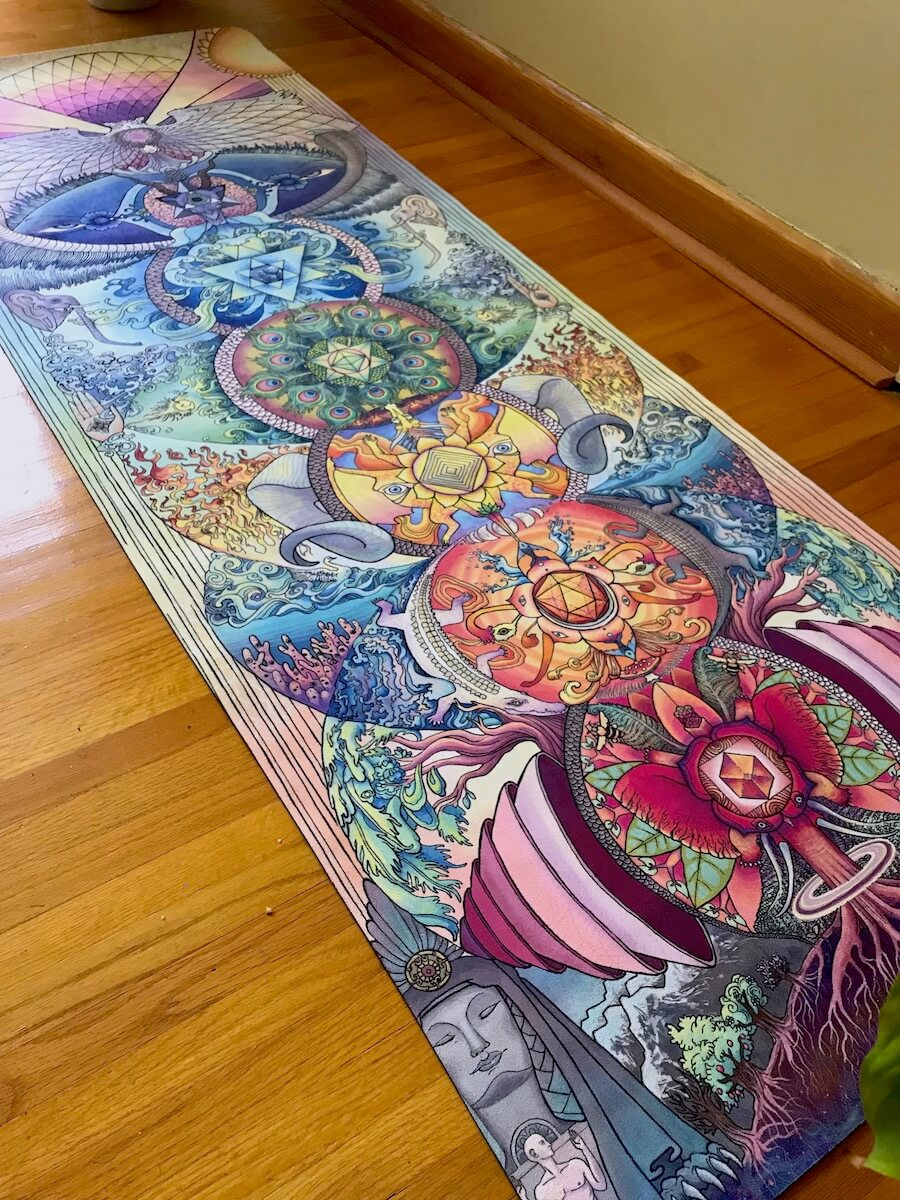 intricately designed yoga mat that demonstrates the chakras by artist danielle caners
