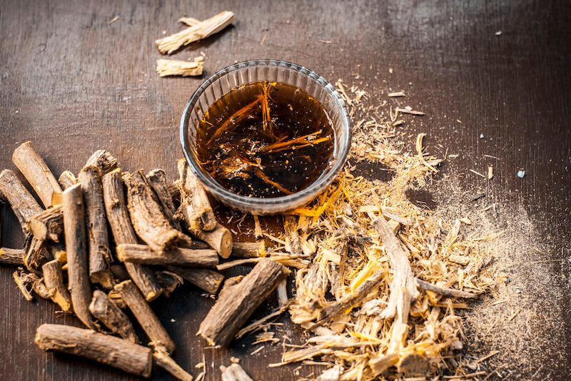 dried licorice root with steeped licorice tea