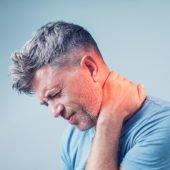 man holding neck after whiplash injury