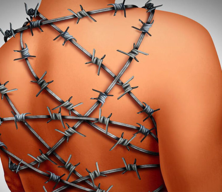 human body wrapped in barbed wire to demonstrate the pain of chronic inflammation