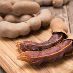 tamarind fruit on cutting board