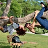 mother and son hanging on a tree laughing