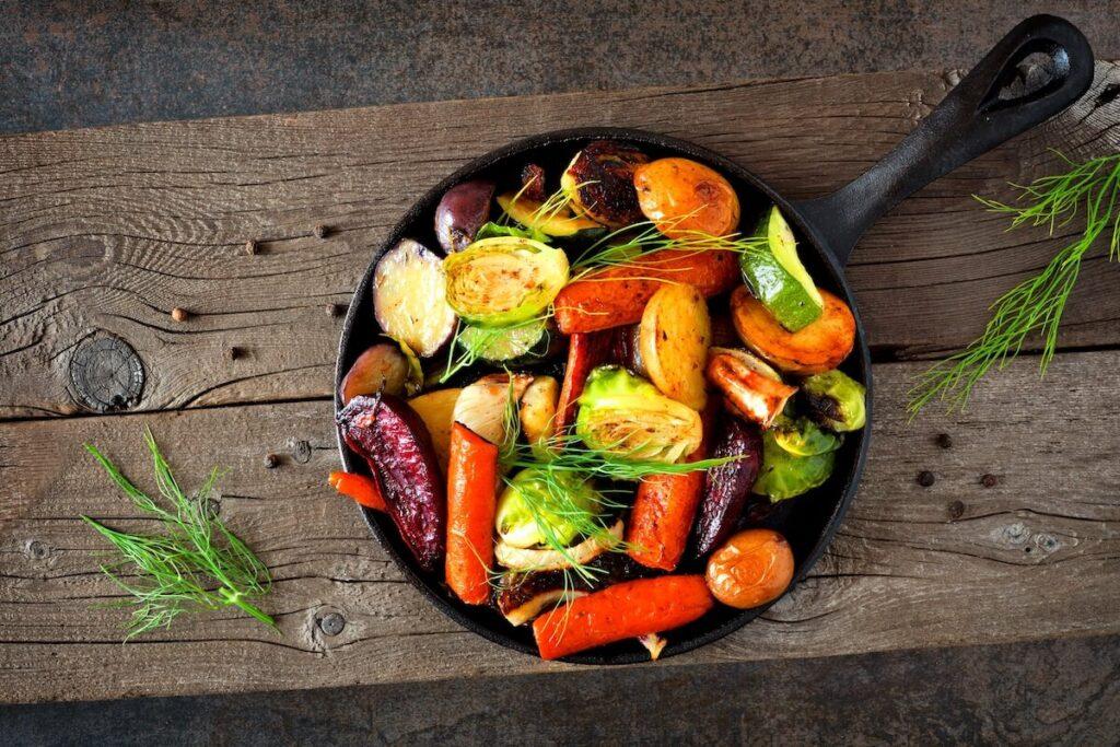 Cast iron skillet of roasted autumn vegetables